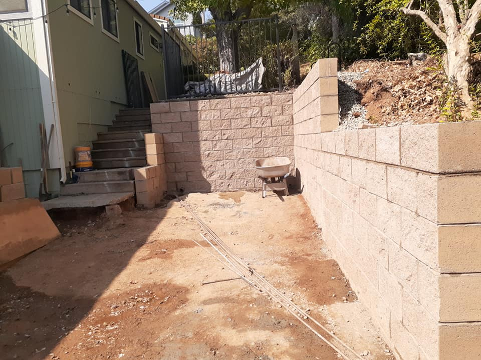A functional retaining wall built our of conder blocks